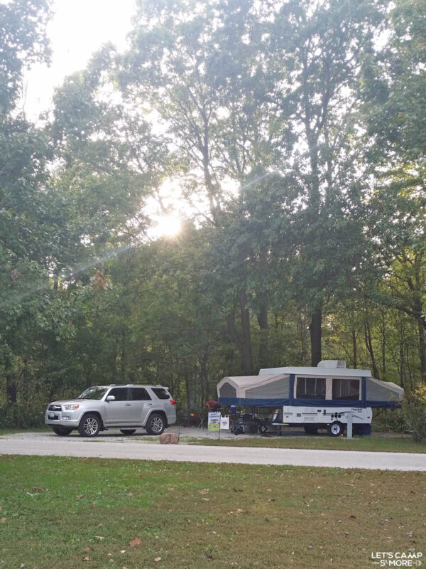 Toyota 4Runner and a pop-up camper trailer set up at a campground in Illinois
